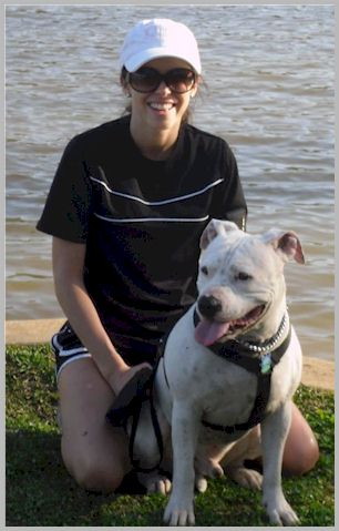 Lauren Hood with her deaf dog, Trump, at the lake.